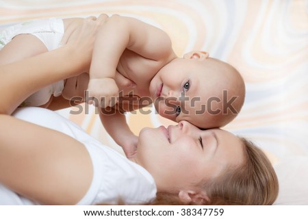 Beautiful baby of six  months old in his mothers hands. - stock photo