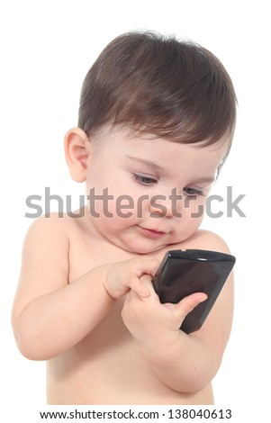 Beautiful baby playing and touching a mobile phone isolated on a white background