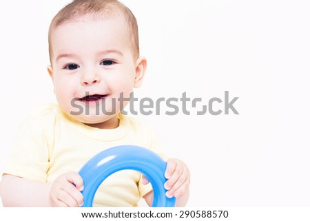Beautiful baby playing with colorful toy