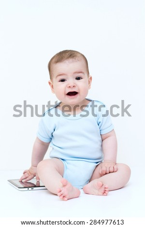 Beautiful baby playing with tablet.