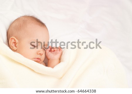 beautiful baby sleep on a white background