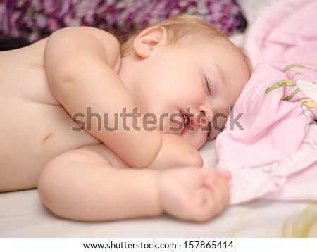 Beautiful baby sleeping with open mouth