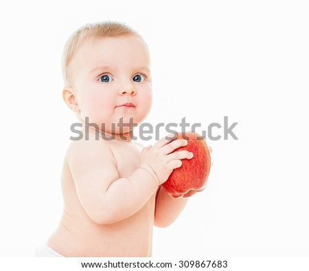 Beautiful baby with red apple. Baby eating healthy food isolated.