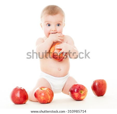 Beautiful baby with red apples. Baby eating healthy food isolated. - stock photo