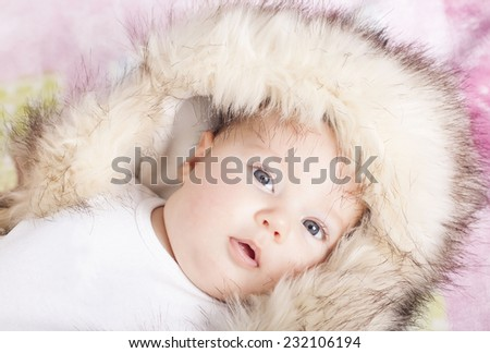 Beautiful baby with winter hat - stock photo