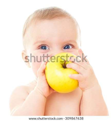 Beautiful baby with yellow apple. Baby eating healthy food isolated. - stock photo