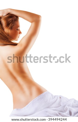 Beautiful back of a young woman after shower isolated on white background - stock photo
