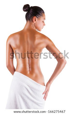 Beautiful back of a young woman isolated on white background