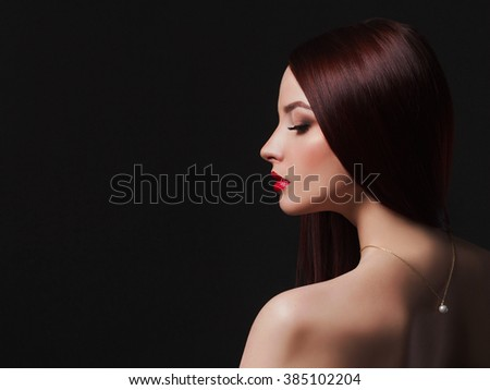 beautiful back of young woman.beauty brunette Girl with a necklace on her back.Elegant fashion glamor photo - stock photo