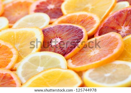 Beautiful background made of colorful citrus fruit slices - stock photo