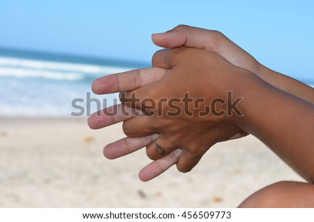 Beautiful background of beach and sea. Hands in front