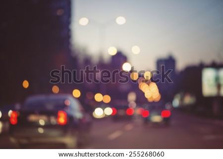 beautiful background of bokeh lights at night on road with car - stock photo