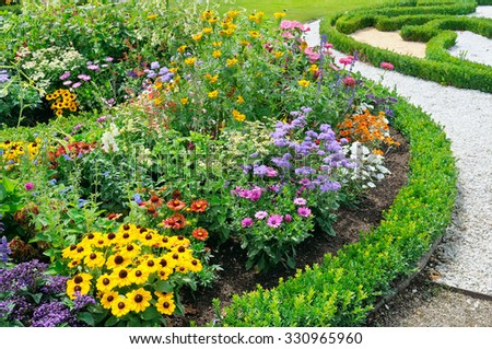 beautiful background of bright garden flowers - stock photo