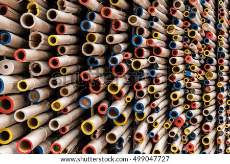Beautiful background of colorful pipes of different size and colors stacked together