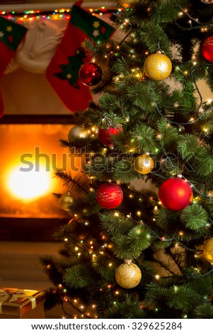 Beautiful background of decorated Christmas tree and fireplace - stock photo