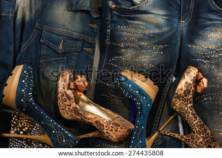 Beautiful background of jeans, jackets and shoes with crystals as background, wallpaper