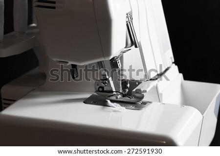 beautiful background sewing electric machine overlock woman leisure lifestyle, shallow depth of field - stock photo