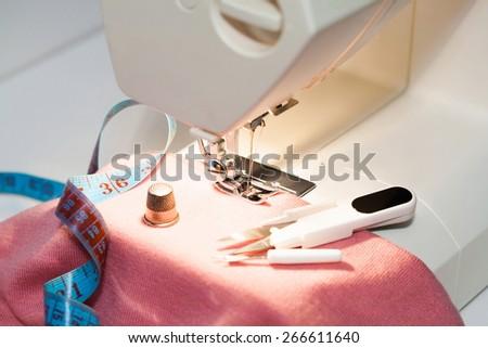 beautiful background sewing electric machine woman leisure lifestyle, shallow depth of field - stock photo