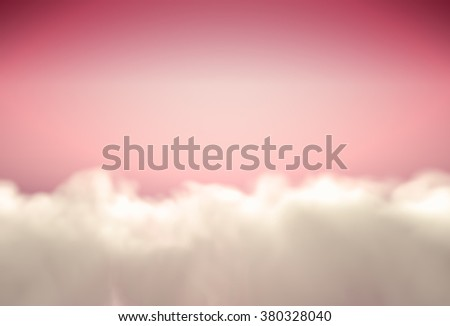 Beautiful background with fluffy clouds at pink sky - stock photo