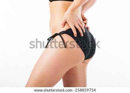 Beautiful backside in a blue bikini - stock photo