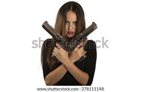 Beautiful bad girl holding guns in white background isolated - stock photo