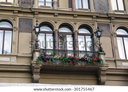 Beautiful Balcony with geraniums hang-downing on an old house, Vienna