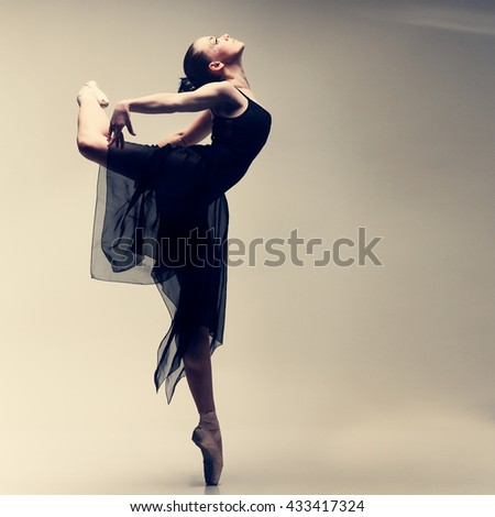 Beautiful ballet-dancer, modern style dancer posing on studio background - stock photo
