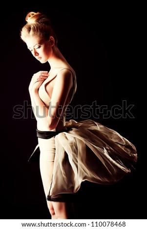 Beautiful ballet dancer posing at studio. - stock photo
