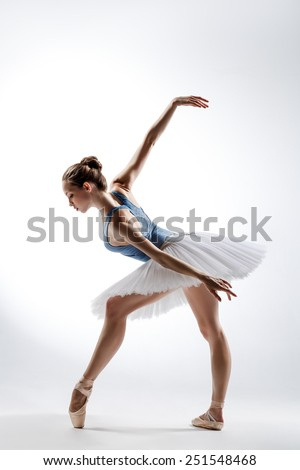 beautiful ballet dancer posing on a studio background - stock photo