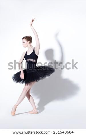 beautiful ballet dancer posing on a studio background - stock photo