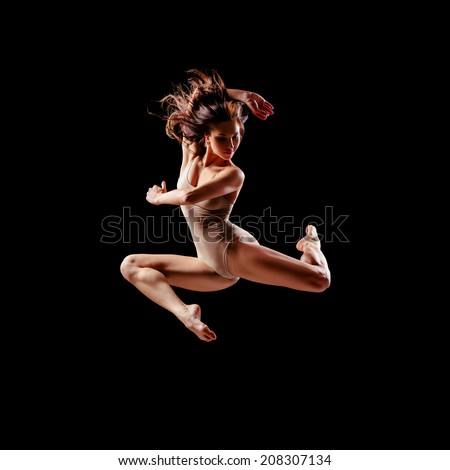 beautiful ballet dancer posing on black studio background - stock photo