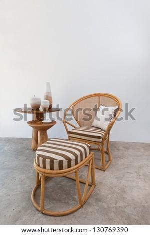 Beautiful bamboo rattan furniture in a summer setting - stock photo