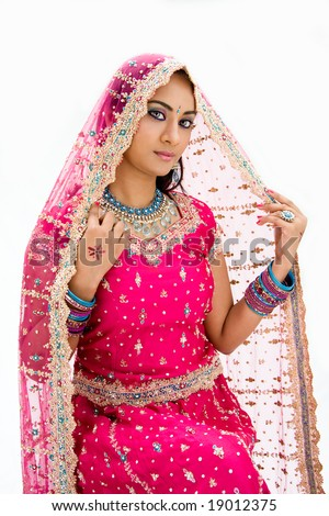 Beautiful Bangali bride in colorful dress and veil, isolated - stock photo