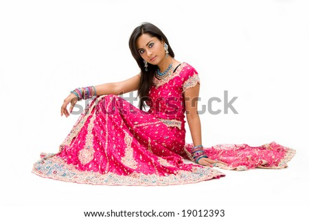 Beautiful Bangali bride in colorful dress sitting, isolated - stock photo