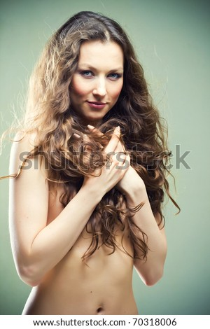 Beautiful bare young woman with long curly hair