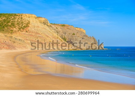 Beautiful bay and beach with azure sea in Luz town, Algarve region, Portugal - stock photo