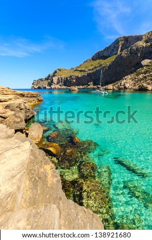 Beautiful bay beach turquoise sea mountains, Cala Figuera on Cap Formentor, Majorca, Spain