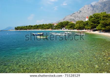 Beautiful bay with boats on Makarska Riviera - stock photo