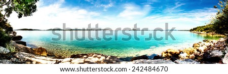 beautiful beach and cristallic turquoise adriatic sea, mediterranean sea, coast landscape, in background island murter, dalmatia, panorama format - stock photo