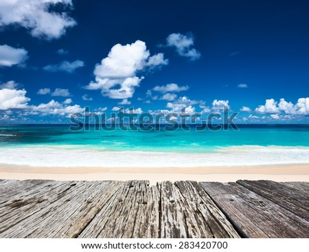 Beautiful beach and old wooden pier at Seychelles, La Digue - stock photo