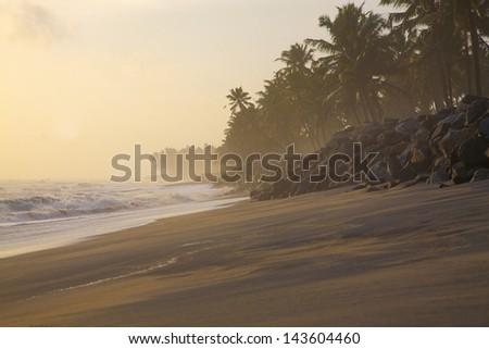 Beautiful beach and rocks around Varkala beach at sunset, Kerala, India. - stock photo