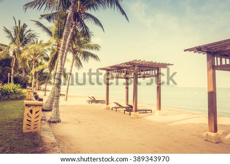 Beautiful beach and sea with empty chair on tropical beach - Filter effect and boost up color Processing
