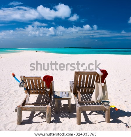 Beautiful beach at Maldives with chaise-lounges at christmas