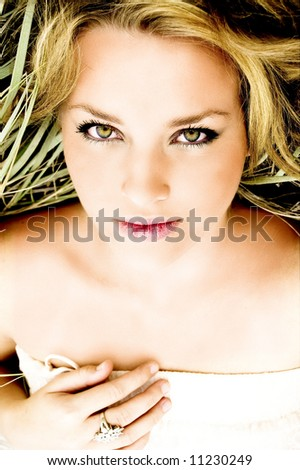 Beautiful beach babe relaxing on holiday - stock photo