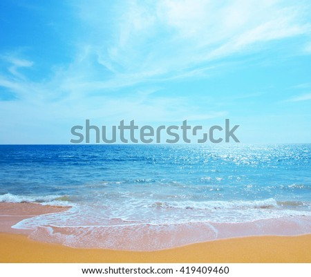 Beautiful beach blue sea wave summer sunny tropical - Leisure relax Concept - stock photo