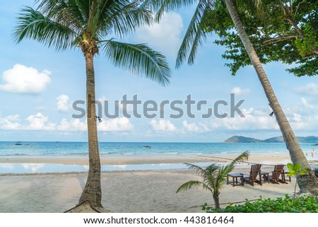 Beautiful beach chairs on tropical white sand beach - stock photo