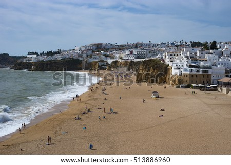 Beautiful beach of Albufeira with the stunning white houses at the background, Albufeira Algarve Portugal October 2016