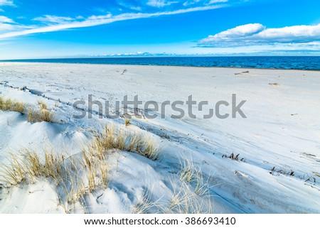 Beautiful beach sea landscape. Sandy beach and sand dune with grass, Leba, Baltic Sea, Poland - stock photo
