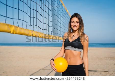 Beautiful beach volleyball female player portrait. - stock photo