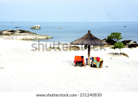 Beautiful Beach with African Umbrella on Lake Malawi, Africa  - stock photo
